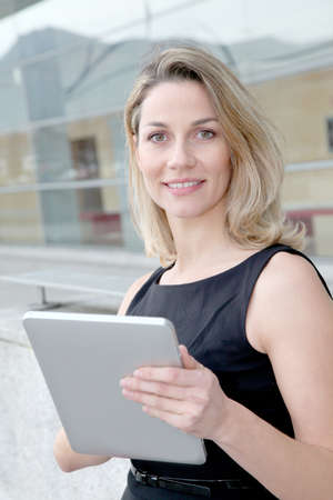 android tablet: Businesswoman using electronic tab outdoors