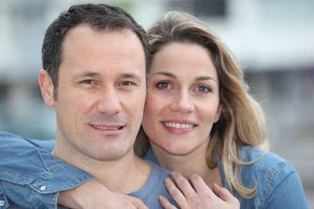 Portrait of happy couple standing outdoors photo