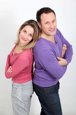 Happy couple standing on white background photo