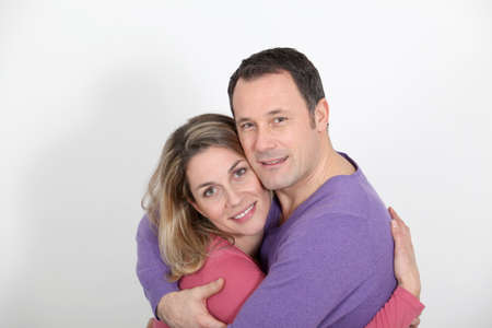 Portrait of in loved couple standing on white background photo