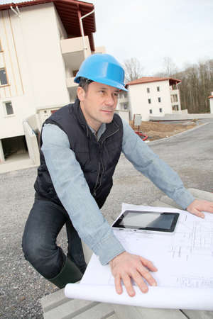 Engineer on construction site with electronic tab photo