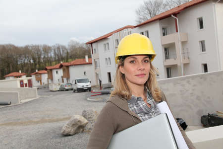 Woman engineer with security helmet standing on construction site photo