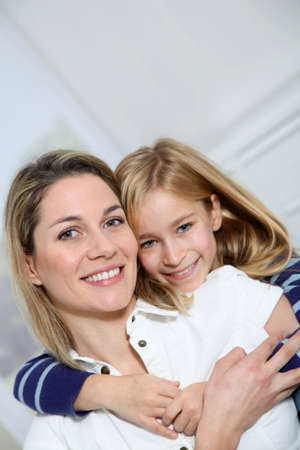 Portrait of happy mother and little girl photo