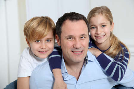 Portrait of father and children at home photo
