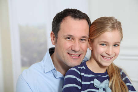 Portrait of father and daughter photo