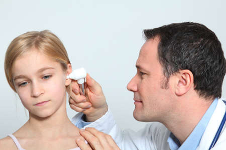 Doctor doing child medical check-up photo