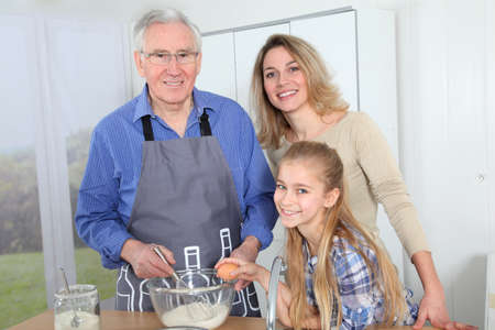 70 year old man: Grandfather, mother and daughter baking