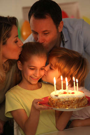 Family celebrating childs birthday photo