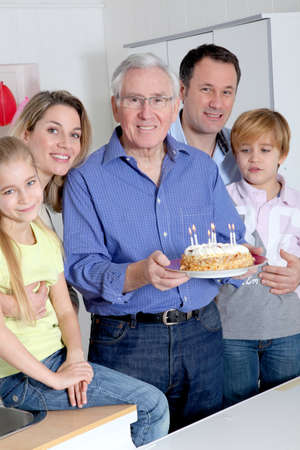 Family celebrating grandfathers birthday photo