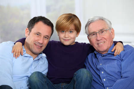sons and grandsons: Three-generation family portrait Stock Photo
