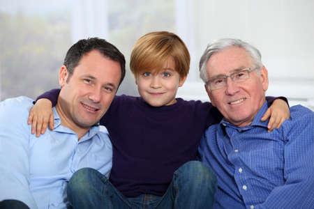 grandfather and grandson: Three-generation family portrait Stock Photo