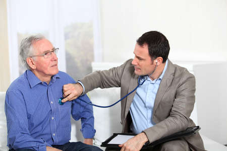 exams: Doctor examining elderly mans health