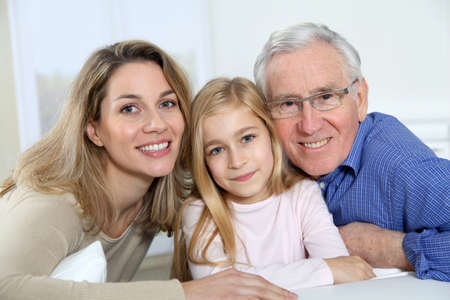 Portrait of smiling grandpa, mother and child  photo