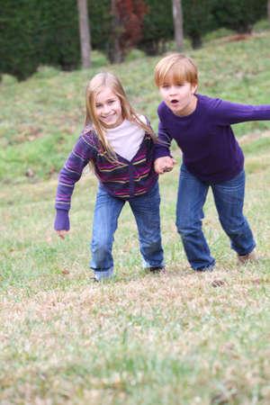blond boy: Kids having fun running in park