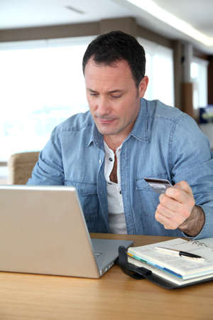 Man in front of computer doing online payment Stock Photo - 9031584
