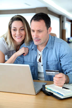 credit card payment: Couple doing online shopping wih laptop computer Stock Photo