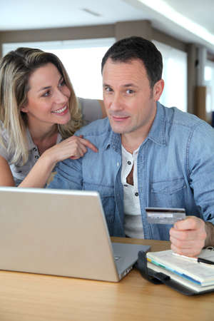 Couple doing online shopping wih laptop computer Stock Photo - 9031640