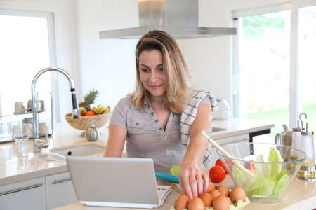 Woman in kitchen preparing lunch Stock Photo - 9031571