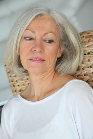 Closeup of senior woman relaxing at home photo