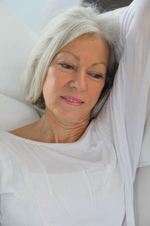 Closeup of senior woman relaxing at home photo