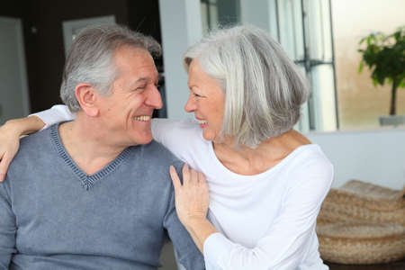 Happy senior couple looking at each other photo