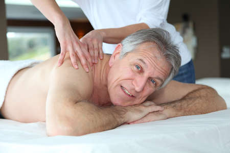 Senior man having a massage photo