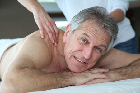 Senior man having a massage photo