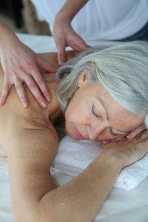 Senior woman having a massage photo