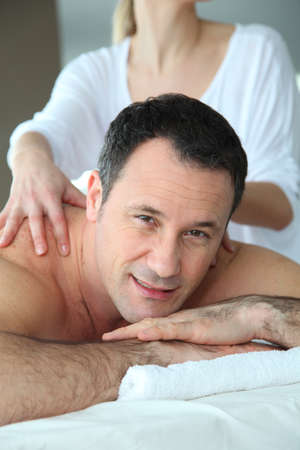 Handsome man having a massage Stock Photo - 9031782