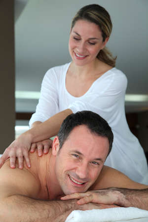 Handsome man having a massage Stock Photo - 9031765