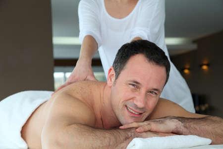 Handsome man having a massage Stock Photo - 9031721