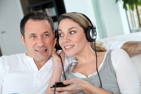 Couple listening to music with headphones Stock Photo - 8794122