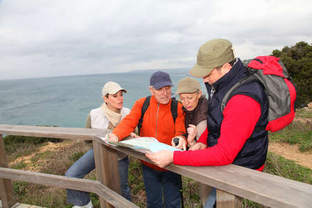 rambling: Group of people looking at map on a hiking day