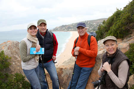 rambling: Group of hikers standing in natural trail Stock Photo