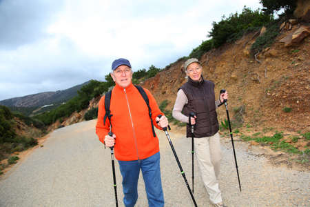 Senior couple on a walking day photo