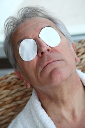 at ease: Senior trying to ease eyes pain Stock Photo