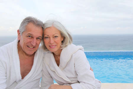 Portrait of happy senior couple in spa center photo
