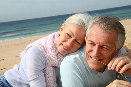 Happy senior couple at the beach photo