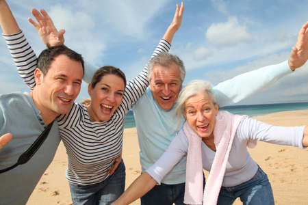 old people group: Family vacation at the beach