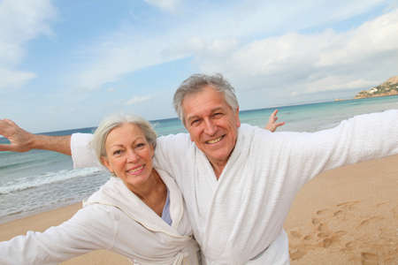 retired: Senior couple in bathrobe at the beach