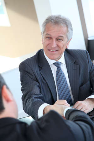 Real-estate-agent shaking hand to new property owner Stock Photo - 8742515