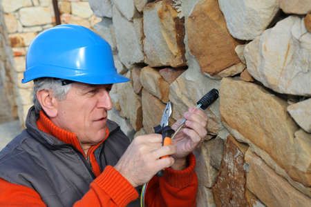 Worker with security helmet installing gate system Stock Photo - 8794443