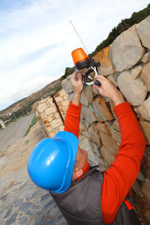 Worker with security helmet installing gate system Stock Photo - 9065069
