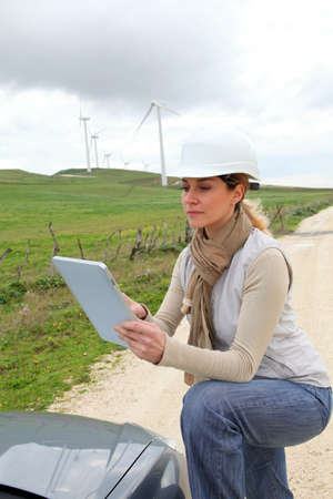 Engineer in wind turbines field using electronic tablet photo