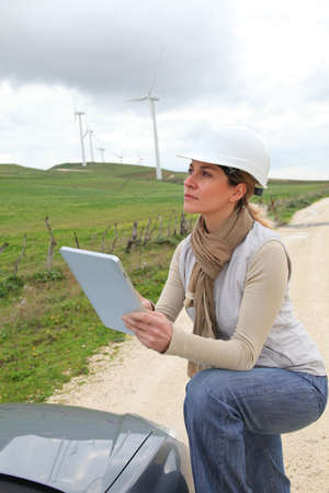 electronic tablet: Engineer in wind turbines field using electronic tablet