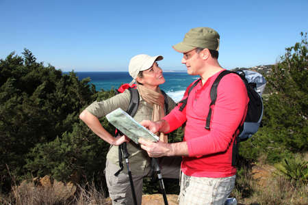 rambling: Couple looking at map on a hiking day