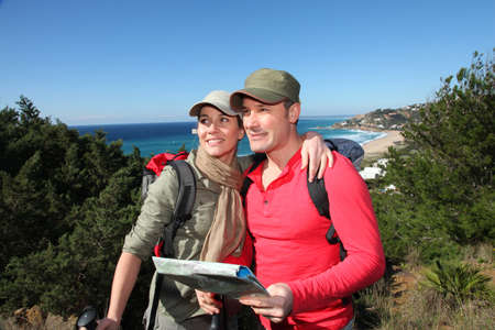 Couple looking at map on a hiking day photo