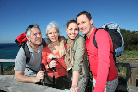 rambling: Portrait of happy group of hikers Stock Photo
