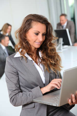 Portrait of smiling businesswoman in office Stock Photo - 8916607