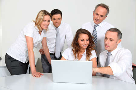 30s adult: Group of office workers in front of laptop computer